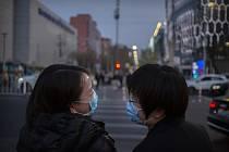 Lidé na ulici v Pekingu