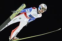Skokan na lyžích Rune Velta.