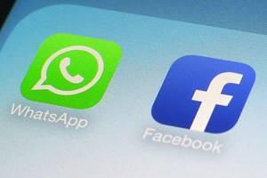 Ikonky aplikací Facebook a Whatsapp na mobilním telefonu