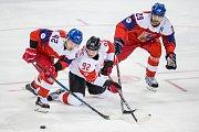 Čeští hokejisté (v červeném) proti Kanadě v bitvě o bronz na olympijských hrách v Pchjongčchangu.