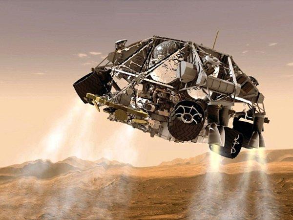 Robotické vozítko Curiosity na planetě Mars.