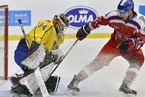 Tomáš Filippi před švédským gólmanem Joelrm Lassinanttim.