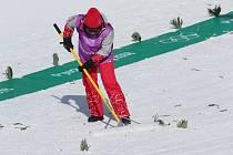 Úprava olympijské tratě v Pchjongčchangu.