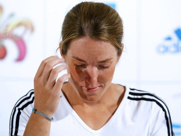 Justine Heninová na tiskové konferenci.