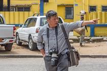 Zadržený čínský fotoreportér Lu Kuang.