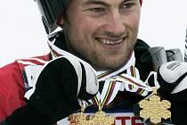 Nor Petter Northug se třemi zlatými medailemi.