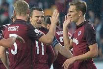 Fotbalisté Sparty (zleva) Jakub Brabec, David Lafata a Bořek Dočkal se radují z gólu proti Slovácku.