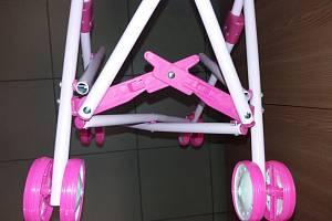 Kočárek golfky Doll Carrier, zjištěná závada hračky – chybějící ochranné součásti
