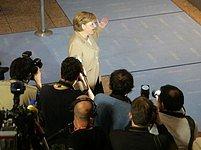 Angela Merkelová před novináři.