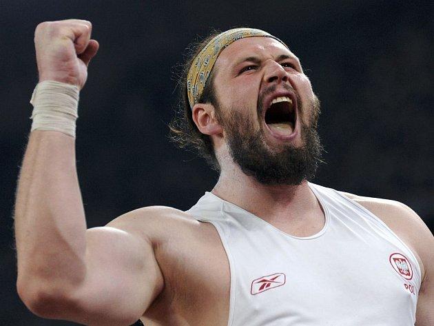 Tomasz Majewski převálcoval ve vrhu koulí všechny favority a díky osobnímu rekordu 21,51 metru se stal olympijským vítězem.
