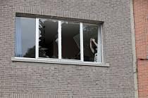 Poškozený dům v Antverpách.