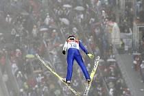 Sdruženář Tomáš Portyk v závodě na velkém můstku na olympijských hrách v Soči.