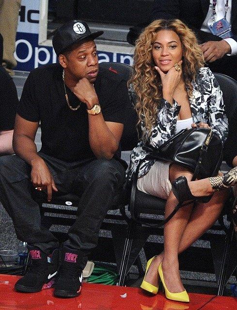 Raper Jay-Z a zpěvačka Beyoncé na Utkání hvězd NBA.