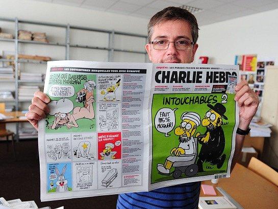 Do redakce francouzského týdeníku vpadli útočníci, zabili 11lidí. Na snímku Charb, karikaturista a šéfredaktor satirického časopisu Charlie Hebdo.