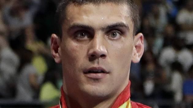 Úřadující mistr světa i Evropy Rus Jevgenij Tiščenko vyhrál olympijský turnaj boxerů do 91 kg.
