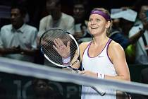 Lucie Šafářová se raduje z výhry.