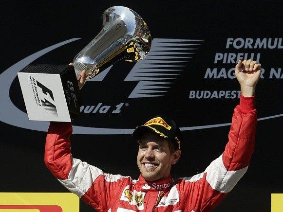 Sebastian Vettel slaví vítězství