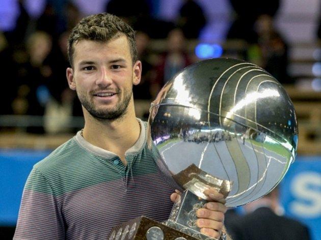 Bulharský tenista Grigor Dimitrov slaví první titul v kariéře.