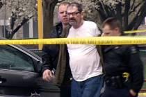 Glen Cross při zatýkání v dubnu 2014.