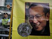 Čínský disident Liou Siao-po na plakátě.