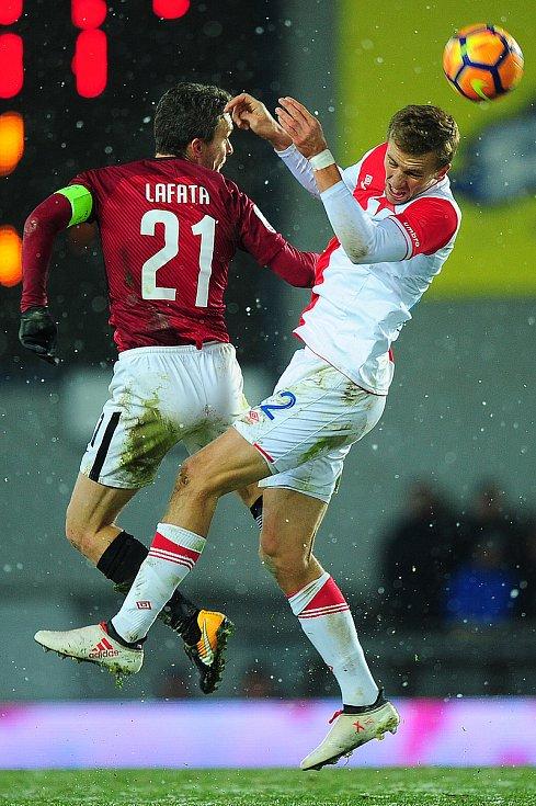 Fotbalové utkání HET ligy mezi celky AC Sparta Praha a SK Slavia Praha 17. března v Praze. David Lafata vs. Tomáš Souček.