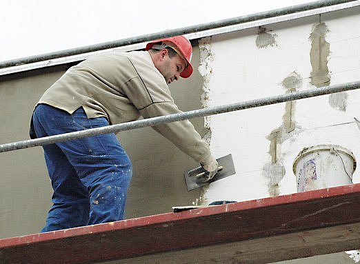 Zateplování budovy. Ilustrační foto