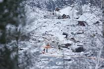Záchranáři pracují v norské vesnici Ask, kterou zasáhl mohutný sesuv půdy