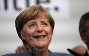 Angela Merkelová slaví čtvrté vítězství