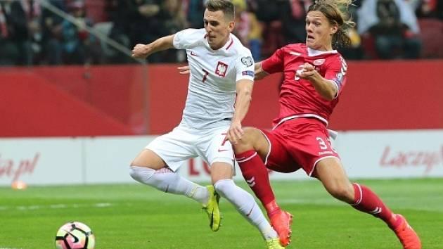 Arkadiusz Milik (v bílém) se zranil v utkání s Dánskem