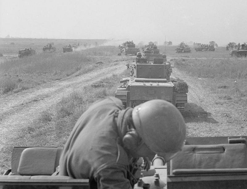 Polští vojáci bojující během 2. světové války na straně Spojenců - zde při bojích v Normandii