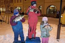 ŽIVÉ KAPŘÍKY si jako svoji zaslouženou výhru odnášeli také nejmladší účastníci 9. ročníku Běhu o vánočního kapra v Bruntále.