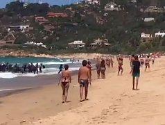 Běženci na španělské pláži
