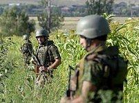 Gruzínští vojáci kontrolují oblast...