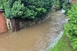Rozlitý rybník v Mikulášovicích