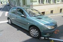 Nehoda auta a koloběžky.