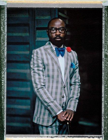 """Kilani """"Big Ben"""" Ebenezer založil svou značku pánských oděvů pro náročné vroce 2012. Odva roky později mu jeho odvážné modely přinesly nasoutěži Lagos Fashion Awards 2014 uznání jako nejlepšímu pánskému návrháři."""