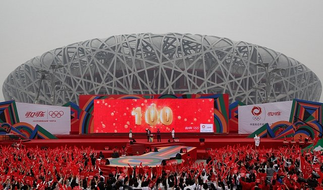 BEIJING, CHINA - APRIL 18:  Chinese people celebrate during a Coca-Cola ceremony to mark 100-day countdown to London 2012 Olympic Games at National Stadium, also known as the Bird\'s Nest, on April 18