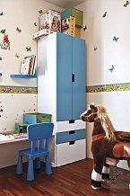 Dětskému pokoji syna Daniela dominuje modrá a bílá barva.