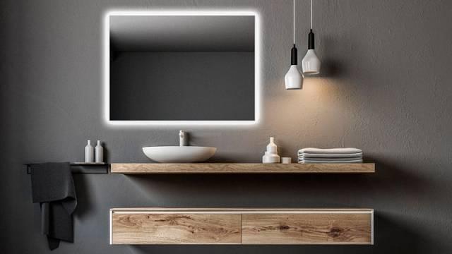 Zrcadlo Ambiente s podsvícením po celém obvodu o rozměrech 100 x 70 cm, cena 5873 Kč.