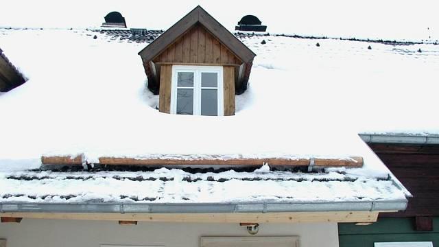Sněholam s kulatinou