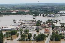 Golfové hřiště v Terezínské kotlině zcela zaplavila červnová povodeň.