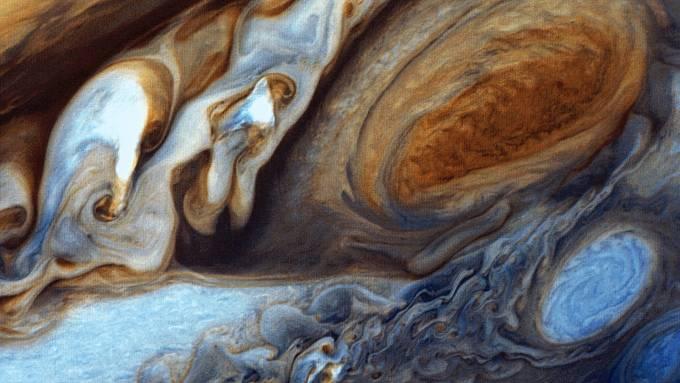 V roce 1979 vyfotografovala sonda Voyager 1 mračna v atmosféře největší planety sluneční soustavy Jupiteru, které bývají označovány jako Great Red Spot.