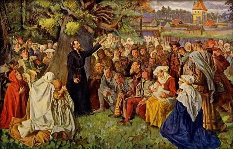 Jan Hus káže v blízkosti Kozího Hrádku u Sezimova Ústí.
