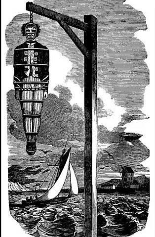 Tělo piráta kapitána Kidda bylo pro výstrahu vyvěšeno v okovech.