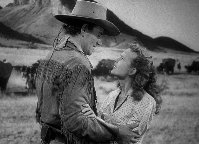 John Wayne a Coleen Gray ve filmu Červená řeka