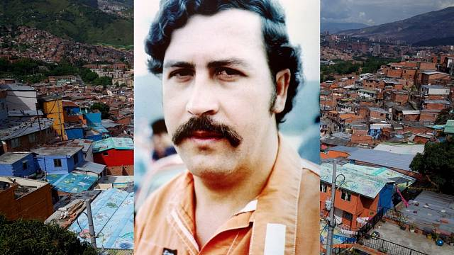 Pablo Escobar, na pozadí město Medellín