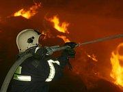 Požár stohu u Vysočan