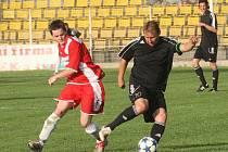 Utkání Blšan (v černém) proti týmu Modré