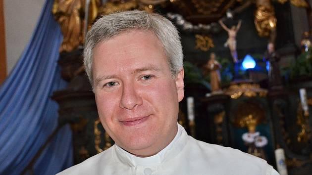 Farář Vilém Marek Štěpán v kostele v Liběšicích