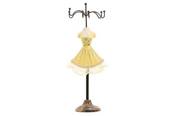 Stylizovaný věšáček na šperky v podobě dámských šatů.